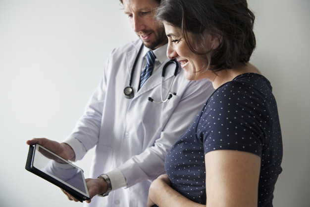 Women Health Center in Amritsar | Best Gynecologist Doctor in Amritsar - Pregnant woman having fetal monitoring by doctor